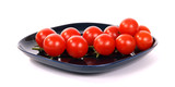 cherry tomato --is a smaller garden variety of tomato, on a white background