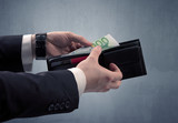 Businessman's hand in suit takes out eruo from his wallet - 230039251