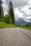 scenic empty road mountain pass in julian alps, slovenia  - 230042092