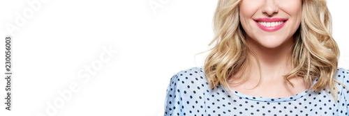 Beautiful young blond smiling woman with clean skin, natural make-up and perfect white teeth isolated over white background. Banner with copy space.