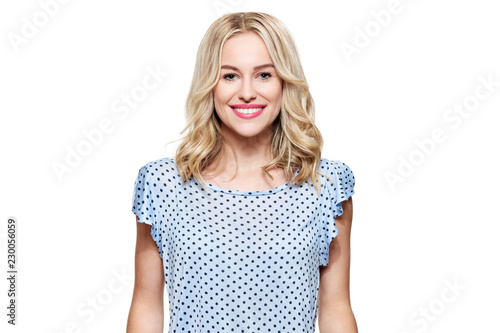 Beautiful young blond smiling woman with clean skin, natural make-up and perfect white teeth isolated over white background.