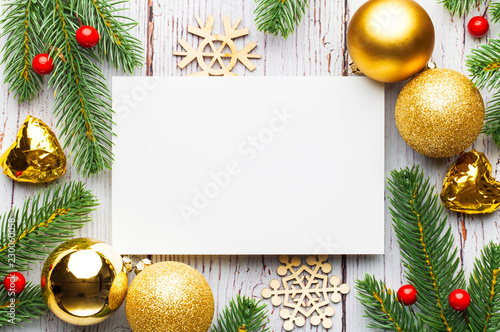 Christmas tree branches, blank paper with decoration. - 230060058