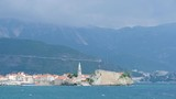 View to the Old Town of Budva in Montenegro in sunny summer day - 230064459