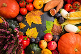 Healthy food background with autumnal vegetables and fruits. Autumn fruits vegetables and leaves. Thanksgiving day concept. Top view