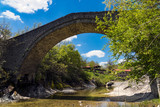 View of the restored traditional stone bridge of Chrysavgi in Thessaly, Greece