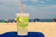 Quadro Glass with caipirinha on the beach of Copacabana (Rio de Janeiro, Brazil)