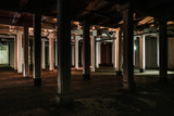 Illuminated poles in the basement of an industrial warehouse - 230103222