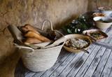 basket full of loafs of bread - 230115461