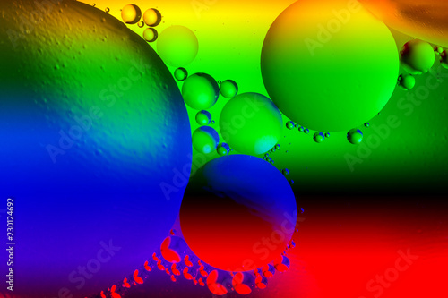 Leinwandbild Motiv Abstract background with colorful gradient colors. Oil drops in water abstract psychedelic pattern image. Vibrant colored abstract pattern