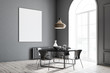 Gray dining room corner, black table, poster