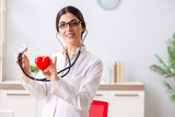 Young doctor in heart care concept - 230155836