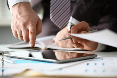 Leinwanddruck Bild Two businessman are looking and