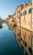 Colored buildings reflection of Vena canal in Chioggia - Italy