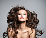 Face of a beautiful  woman with long flying   hair - 230195091