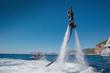Leinwandbild Motiv Flyboarding and seariding on the Sea near the mountain island. Water summer extreme sports.