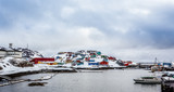 Port with boats and colorful Inuit houses on the rocks in backgr - 230211863