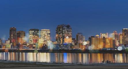 Japan, Osaka city at night with colorful lights and Bokeh © sasinparaksa