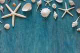 Sea Shell decoration on wooden blue flat background. Free space for your text or product.8 - 230218278