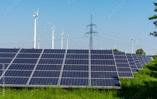Leinwanddruck Bild Wind turbines, electricity pylons and solar panels seen in Germany