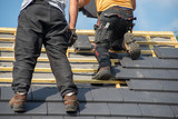 two carpenters working on roof - 230248880