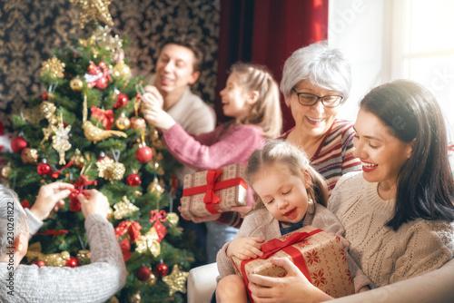 Leinwandbild Motiv family celebrating Christmas