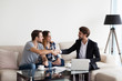 Leinwanddruck Bild - Young couple, family at meeting with realtor, interior designer, decorator, landlord making deal. Husband handshaking with man in suit. Concept of meeting with client, customer