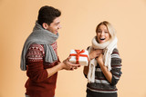 Portrait of a cheerful young couple dressed in sweaters - 230282212