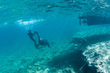 Man with spear gun diving on the breath hold in the underwater in the Mediterranean Sea - 230297487