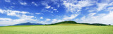 Panoramic landscape, view of green fields and blue sky