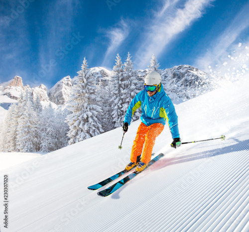 Skier skiing downhill in high mountains - 230307020