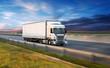 Leinwandbild Motiv Truck with container on road, cargo transportation concept.