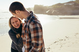 Loving couple having a great time at the beach - 230307693