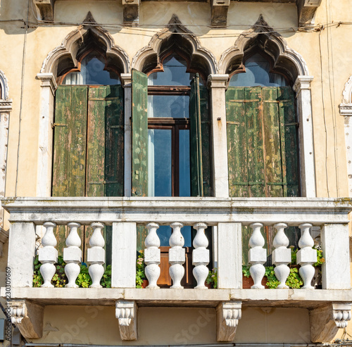 tall windows on an old facade in Italy - 230309669