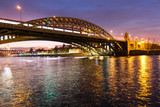 The long beautiful bridge across the river in the evening.