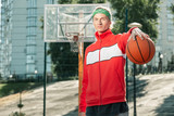 Healthy lifestyle. Pleasant well built men doing sports activities while coming to the basketball court - 230344074