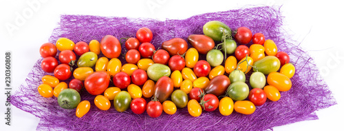 Still life with different color tomatoes