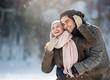 Leinwanddruck Bild - Two young people enjoying in the snow