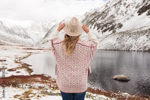 Woman traveler on the background of a beautiful mountain lake - 230362241