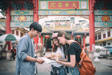 Traveler are discussing about theirs trip at the front of Kuan Yim Shrine ( chinese text) Chinese Temple in Thailand - 230369869