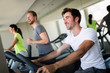 Group of young people running on treadmills in modern sport gym - 230372021