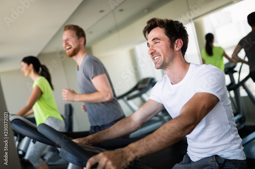 Group of young people running on treadmills in modern sport gym © nd3000