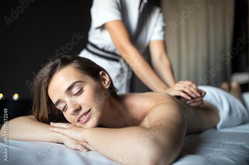 Leinwandbild Motiv Young woman having massage in beauty salon