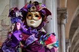 Carnival lilac mask and costume at the traditional festival in Venice, Italy - 230383855