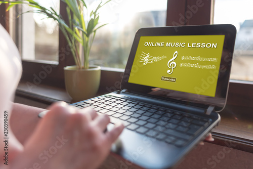 Online music lesson concept on a laptop screen - 230390459