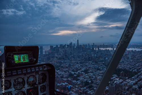 Aerial view from the helicopter cabin on the evening city of New York.