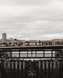 Man running across bridge