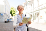 travel, tourism and retirement concept - senior woman or tourist with map on city street - 230401464
