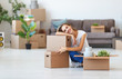 Leinwanddruck Bild - happy   girl with boxes moves to new apartment
