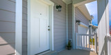 White front door and porch of home on a sunny day - 230407432