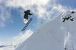 Flying skier on mountains. Extreme winter sport. - 230410093
